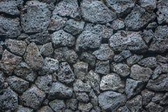 Mattoni di pietra del fondo di struttura del vulcano nella parete immagine stock libera da diritti