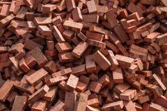 Mattoni rossi impilati sui cantieri Fotografia Stock Libera da Diritti