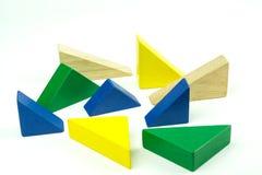 Mattoni variopinti di legno su fondo bianco Giocattolo di legno Fotografia Stock Libera da Diritti
