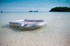 Mattress floating on the beach Stock Photos