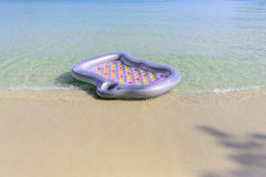 Mattress floating on the beach Stock Images