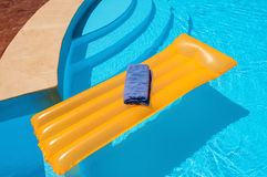 Mattress floating in the pool Stock Image