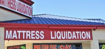 Mattress Liquidation Shop Storefront. A sleep shop sells mattresses at liquidation prices Stock Images