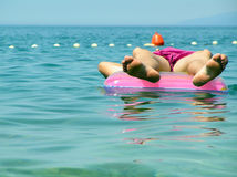 Mattress and man. A man laying on sea in his holidays stock image