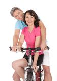 Mature active couple doing sports Stock Images