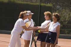 Mature active ladies. Senior ladies shaking hand after tennis match Stock Images