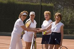 Mature active ladies. Senior ladies shaking hand after tennis match Royalty Free Stock Images