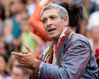 Mature actor clapping in the crowd. AURILLAC, FRANCE - AUGUST 23: mature actor clapping in the middle of the crowd as part of the Aurillac International Street Royalty Free Stock Photos