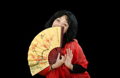 Mature actress plays with Japanese fan Royalty Free Stock Photo