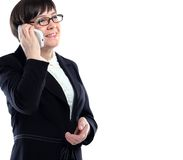 Businesswoman in a black suit calling on a cell phone Stock Image