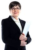 Mature adult businesswoman in a black suit holding Royalty Free Stock Photography