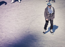 Mature adult at the ice rink Stock Images