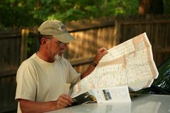 Mature adult man looking at map Stock Images