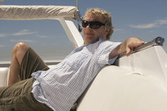 Mature adult man relaxing on boat royalty free stock photo