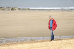 Mature adult man walking on the beach Royalty Free Stock Image