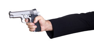 Aiming the Gun. A mature adult man wearing a suit, holding a 9mm gun with both hands aiming it to the target Stock Image