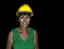 Mature adult woman in hard hat, protective headgear. Royalty Free Stock Photo