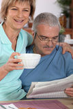 Mature adults at breakfast. Mature adults at the breakfast table Royalty Free Stock Images