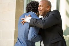 Mature African American casually dressed businessman shaking hands. Royalty Free Stock Image