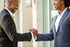 Mature African American casually dressed businessman shaking hands. Stock Images