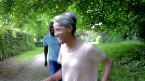 Mature African American Couple Running Along Country Path stock footage