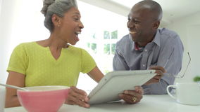 Mature African American Couple Using Digital Tablet At Home stock footage