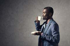 mature african american man drinking coffee stock images