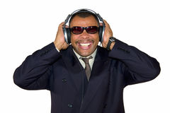 Mature African-American man listening to bad sound Royalty Free Stock Photos