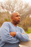 Mature African American man looking sad. Mature African American man in deep thought Royalty Free Stock Image
