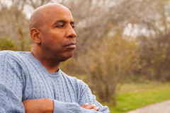 Mature African American man looking sad. Mature African American man in deep thought Royalty Free Stock Photo
