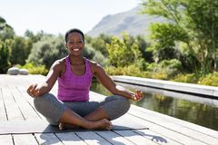 Free Mature African Woman In Yoga Lotus Position Royalty Free Stock Image - 149551976