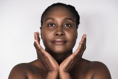 Mature African woman with perfect skin against a white background Stock Photography