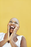 Mature african woman smiling for joy Royalty Free Stock Photos