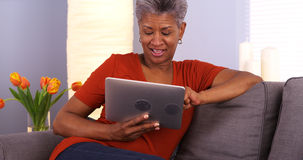 Mature African woman using tablet Royalty Free Stock Photography