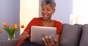 Mature African woman using tablet Stock Photo