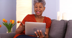 Mature African woman using tablet Royalty Free Stock Photo