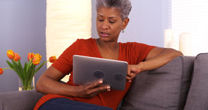 Mature African woman using tablet Royalty Free Stock Photos