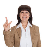 Mature age good looking woman point in finger up. Idea concept Royalty Free Stock Image