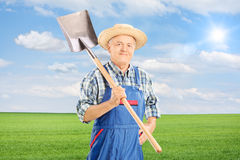 Mature agricultural worker holding shovel Stock Photo