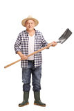 Mature agricultural worker holding a shovel Royalty Free Stock Image