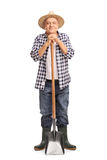 Mature agricultural worker posing with a shovel Royalty Free Stock Photos