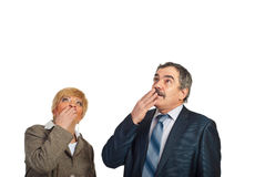 Mature amazed  business people looking up to copy. Two surprised mature business people looking up to copy space isolated on white background Royalty Free Stock Photos