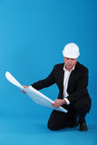 Mature architect with blueprints Stock Photo