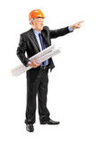 Mature architect holding a blueprint and pointing Stock Photography