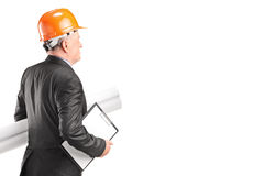 Mature architect holding building plans Royalty Free Stock Photography