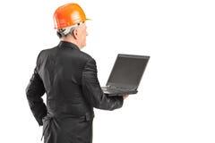 Mature architect holding a laptop Stock Photo