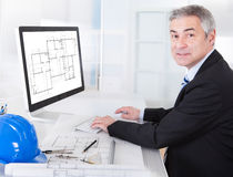 Mature architect male working at the desk Royalty Free Stock Image