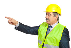 Mature architect man pointing to copy Stock Image
