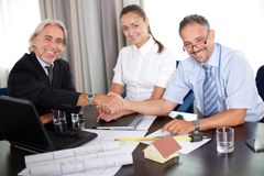 Mature architect shaking hands with a clinet Royalty Free Stock Photo