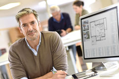 Mature architect sitting at office Royalty Free Stock Photography